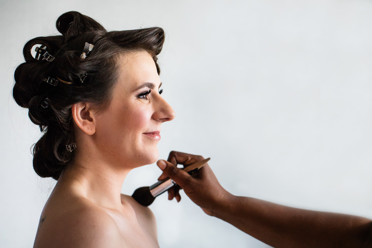 Bride getting gussied up on wedding day
